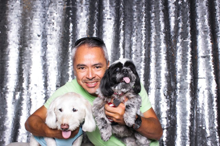 A guy and his two adorable dogs in the culver city photo booth