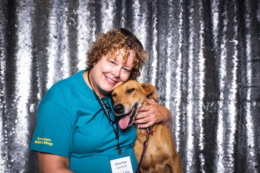 Owner hugging her brown dog in the Culver City Photo Booth