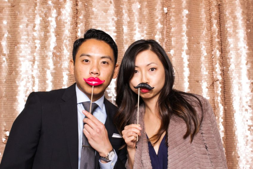 A girl with a fake mustache with a guy wearing fake lips in the Rancho Palos Verde Photo Booth