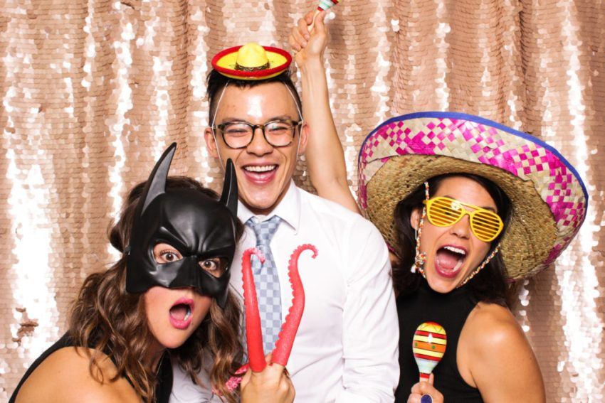 Two girls and a guy dressed up and enjoying the Rancho Palos Verde Photo Booth