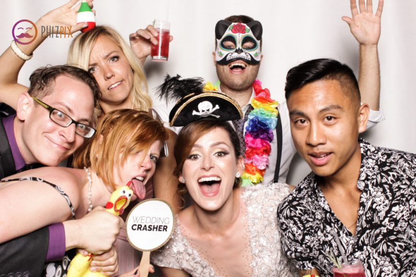 The bride and friends (and the rubber chicken!) pulling funny faces in the Malibu photo booth