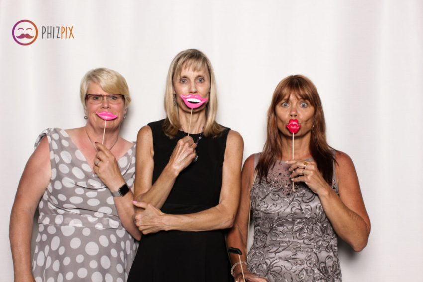 Three ladies making the most of our prop lips in the Malibu photo booth