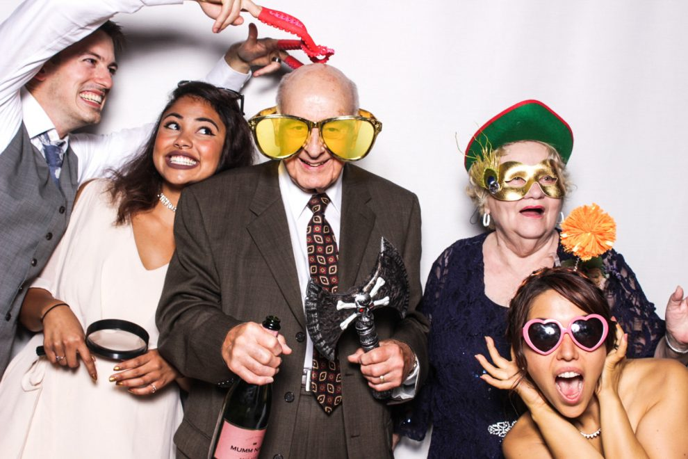 Grandparents having fun with the bride and groom in their Phizpix photo booth rental