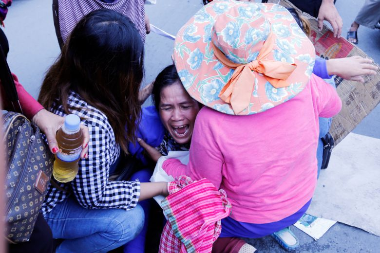 A woman cries as Koh Kong community members gather yesterday outside Land Ministry to protest against a sugar company for land grabbing
