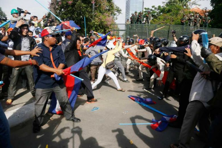 Protesters face off against Daun Penh district security personnel in 2014 at Phnom Penh's Freedom Park after a demonstration turned violent