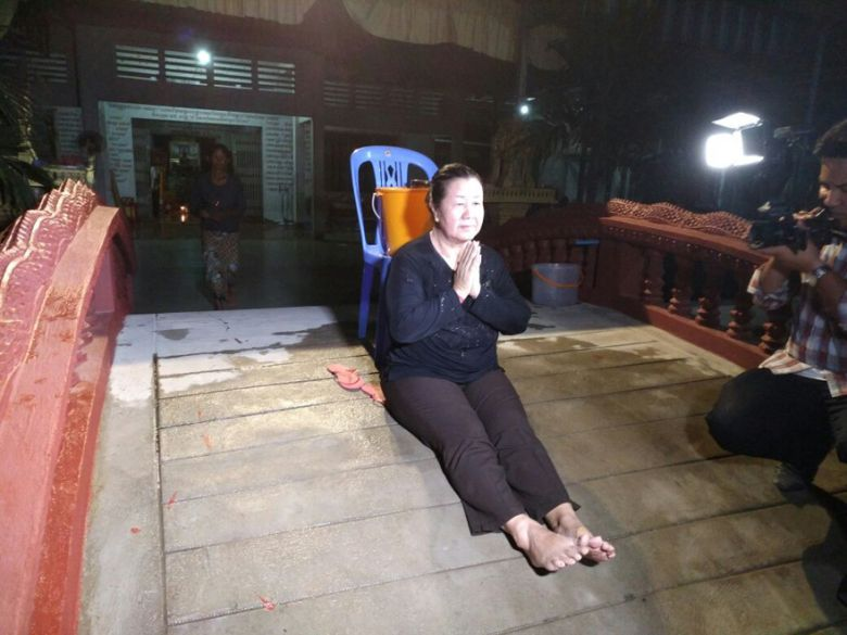 Lim Mony after receiving a blessing from a monk last night in Phnom Penh.