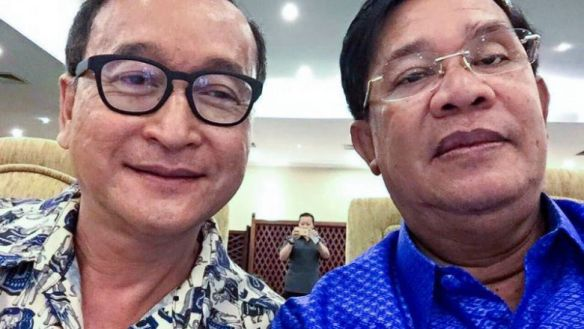 Prime Minister Hun Sen and opposition leader Sam Rainsy pose for a selfie together during a rare political truce in 2015. Supplied