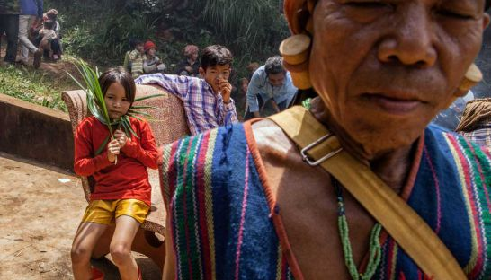 Members of the Bunong indigenous people gather in an area sacred to their community in Mondulkiri province