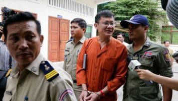 Former Adhoc official Ny Chakrya (top) is escorted outside the Appeal Court in Phnom Penh last year. ACU head Om Yentieng (bottom) speaks to the press last year. Heng chivoan