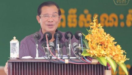 Prime Minister Hun Sen speaks to garment industry workers yesterday in Phnom Penh's Chol Chok district.