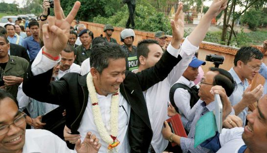 Supporters greet Cambodia National Rescue Party lawmaker-elect Long Ry after his release on bail