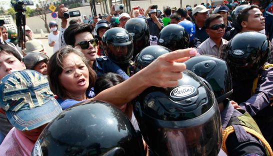 Cambodia National Rescue Party lawmaker-elect Mu Sochua is confronted and blocked by security guards