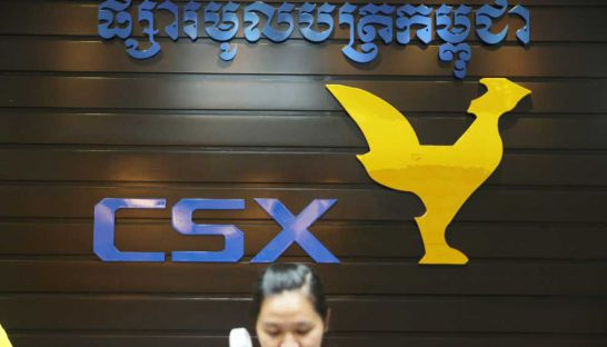 An employee works at the front desk of the Cambodia Securities Exchange