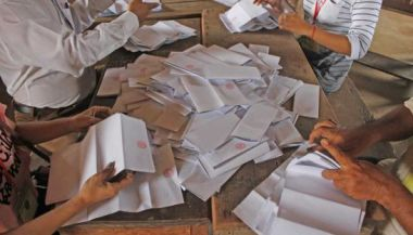 Election officials count votes in Prey Veng province in 2013