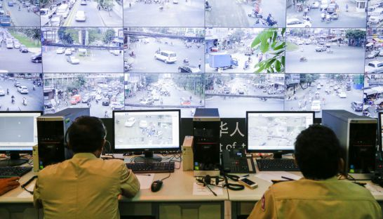 Police officers man computer terminals that are streaming CCTV footage of traffic on the streets of Phnom Penh yesterday morning at the Road Safety Monitoring Center.