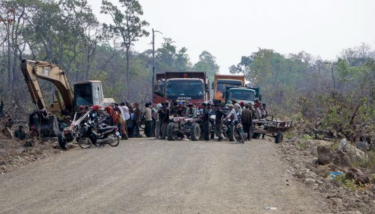 Ethnic Kuoy villagers in Preah Vihear province block Rui Feng trucks and machinery from travelling along a road earlier this week. Photo supplied
