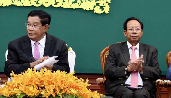 Prime Minister Hun Sen (left) and Defence Minister Tea Banh at an Interior Ministry meeting on Friday in Phnom Penh. FACEBOOK