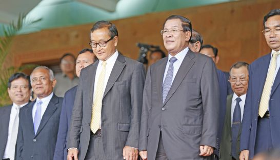 Opposition leader Sam Rainsy and Prime Minister Hun Sen stand on the steps of the Senate last July after a meeting to end the political deadlock. The ruling party has warned the opposition that questioning Tuesday's verdict could jeopardise the culture of dialogue.