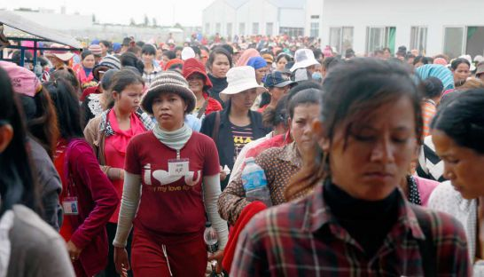 Garment workers exiting the Juhui Footwear factory in Kampong Cham's Cheng Prey district