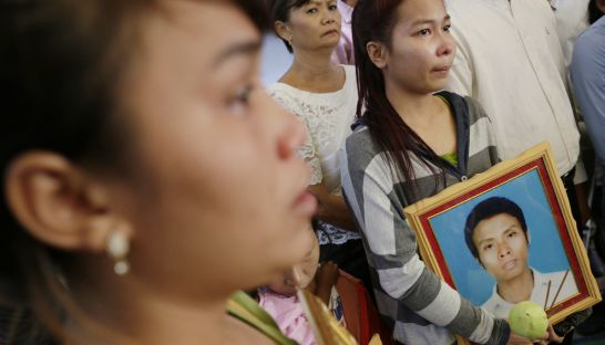 Mourners attend a ceremony at the Cambodia National Rescue Party head office in Phnom Penh