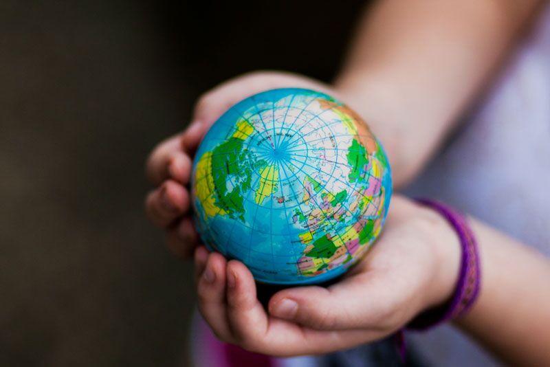 child holding tiny globe