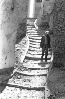 Life – man decends winding steps in old Morocco city