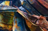 Abstract – pareidolia creature head in colorful sheets of twisted metal