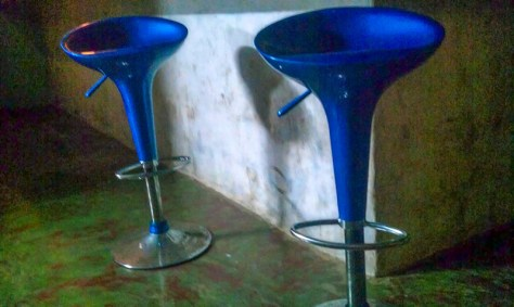 Man-made – Glowing blue barstools await space travelers.
