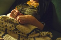 Life – woman's hands rest on crochet yarn