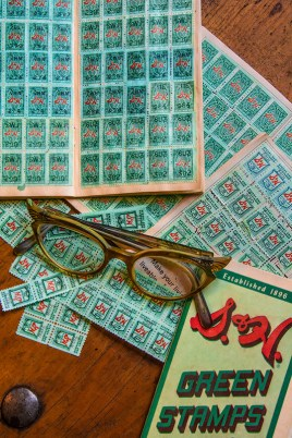 Conceptual – vintage S&H Green Stamps books and eyeglasses
