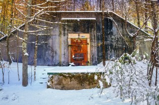 Man-made – facade of WWII ammunition bunker in snow