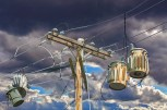 Fantasy – electric transformers hang from utility pole wires like shoefiti
