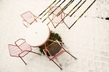 Conceptual – yard furniture apparently moves independently, leaving tracks in snow - fart