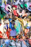 Abstract – compacted bale of colorful recycled plastic items