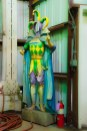 Conceptual – Mardi Gras jester figure in warehouse corner
