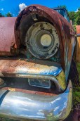 Man-Made – close up of old rusting car left headlight