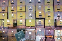 Graphic – abandoned stack of colorful decayed filing cabinet draws