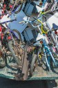 Abstract – bicycles stacked in the bed of a junk truck - fart
