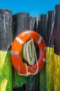 Graphic – life preserver hung on an array of deck pilings - labor
