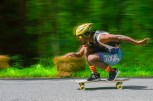 Life – a skateboarder poses before the finish line