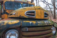 Man-Made – rusting, old, yellow school bus with facial features