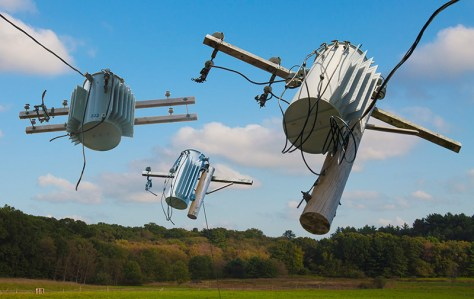 Fantasy – electric transformers float in sky like kites above field