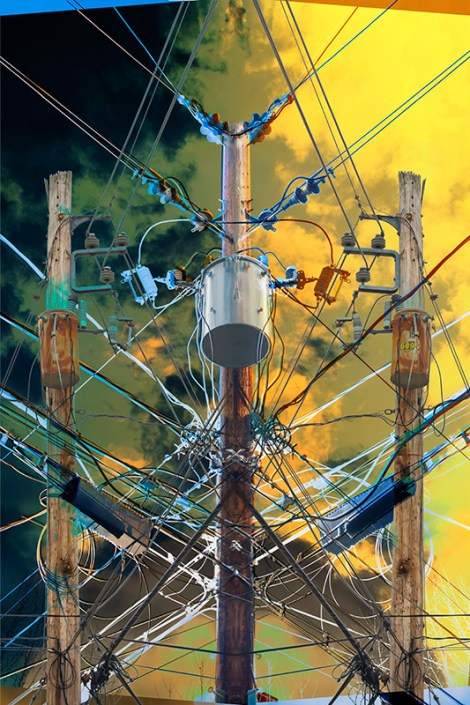 Abstract – electric utility poles and wires as mirror images and blazing sky