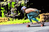 Life – bloodied racer near finish line in skateboarding competition