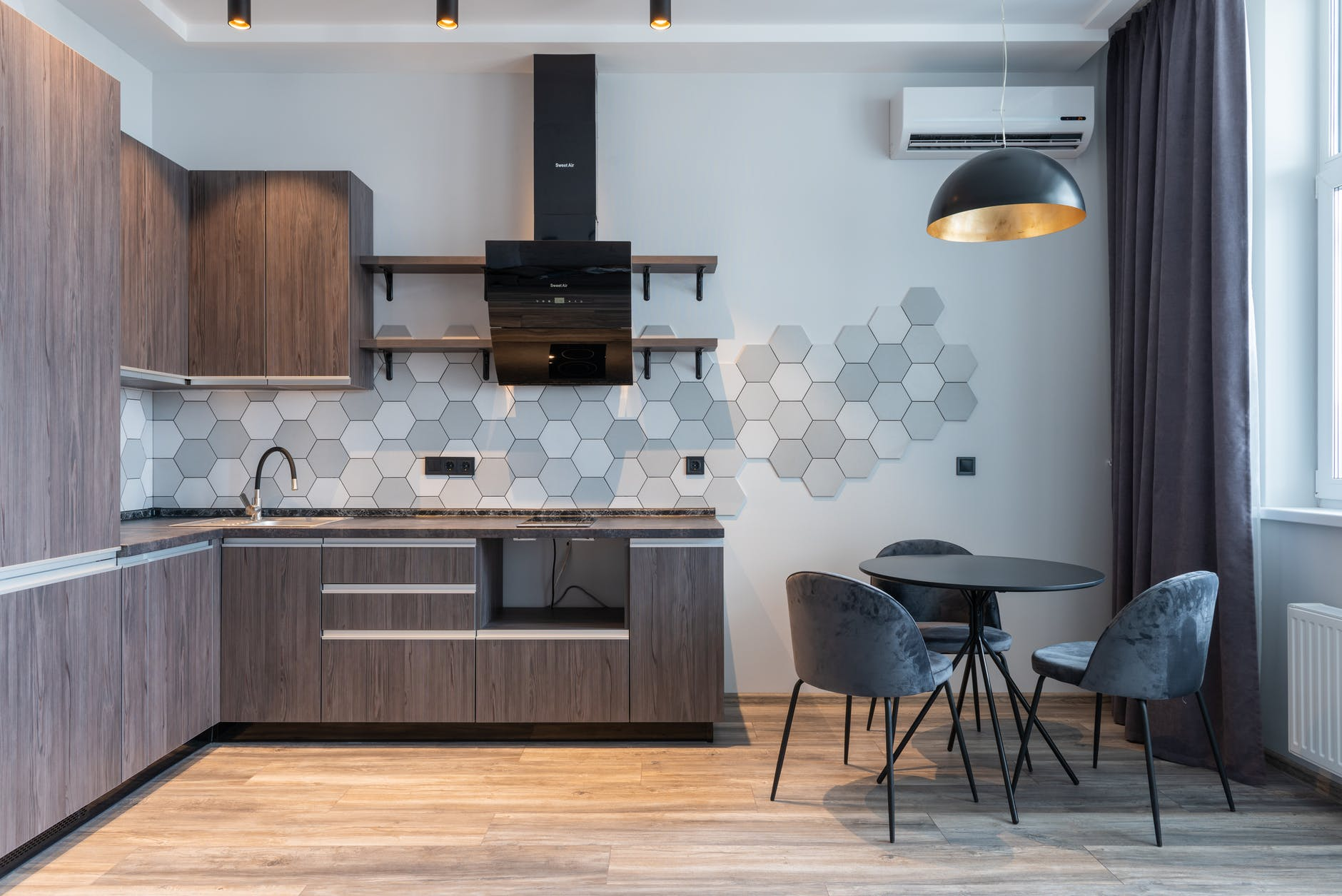 modern kitchen interior with furniture and lamp at home