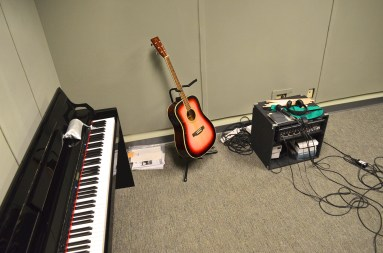 Our music room, complete with acoustic and electric guitars, electric drum kit, a piano, and microphones. A dream for music makers!