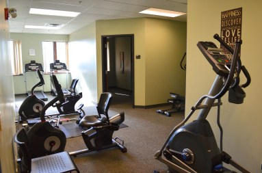 Our workout room, complete with rowing machine, stationary bikes, treadmills, free weights, medicine balls, and kettle bells