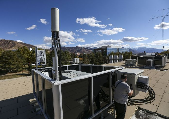 Jonathon Duerig closes up the software defined base station on the roof of the Merrill Engineering Building on the University of Utah campus in Salt Lake City on Friday, Oct. 18, 2019.