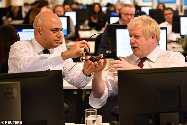 The Prime Minister spent a couple of minutes appearing to work out how to use the system, before Chancellor Sajid Javid handed him his own headset to wear