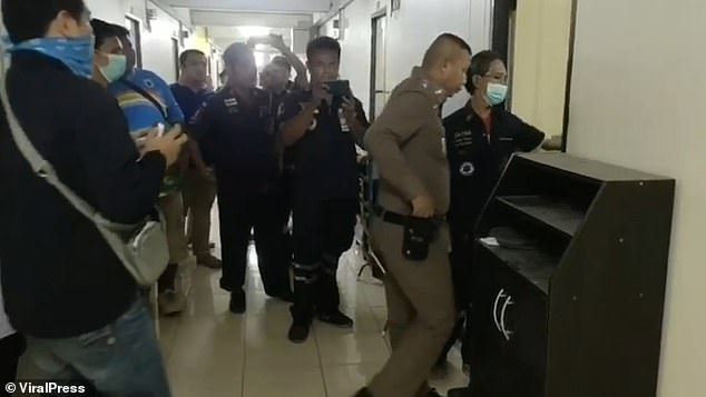 Police and paramedics enter the room whereKanchamaiporn's body was found by a friend